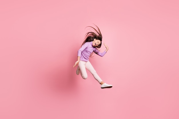 Full body photo of excited girl jump scream her hairstyle fly isolated over pastel color background