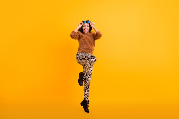Full body photo of funky lady jumping high good mood