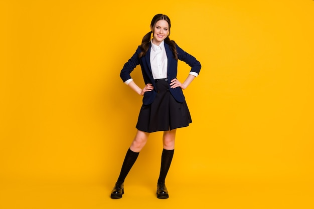 Full body photo of pretty confident student teenager hands waist posing