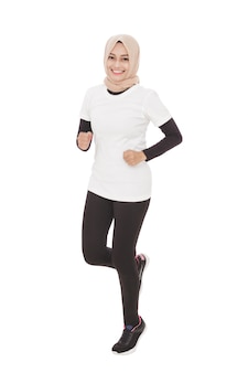 Full body portrait of beautiful asian sporty woman jogging