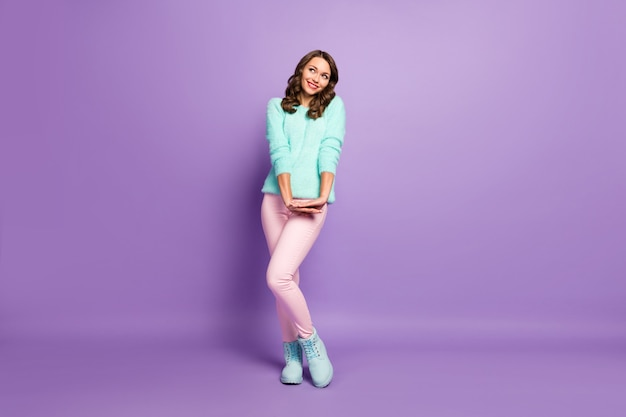 Full body portrait of beautiful lady flirty good mood look up empty space dreamer coquette wear pastel fluffy pullover pink pants boots.