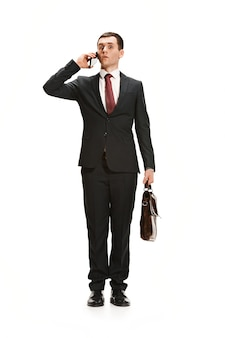 Full body portrait of businessman with briefcase on white
