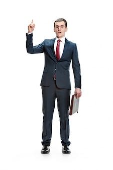 Full body portrait of businessman with folder on white