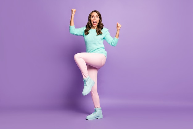 Full body portrait of crazy yelling wavy lady watch sports competition championship raise fists wear fluffy pastel pullover pink pants footwear.