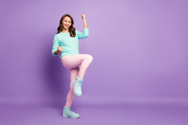 Full body portrait of delighted crazy curly lady celebrate football team winning sports competition leadership wear pastel fluffy pullover pink pants boots.