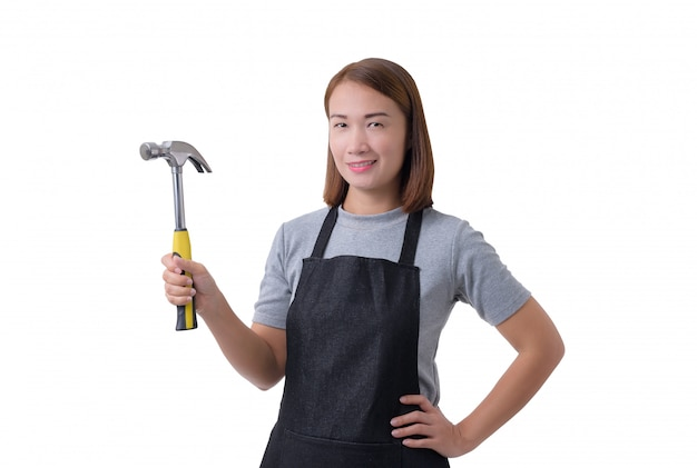 Full body portrait of a worker woman or servicewoman in gray shirt and apron is holding hammer isolated on white background