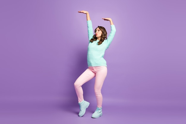 Full body profile portrait of chilling pretty lady raise hands dancing youth modern popular moves wear casual fluffy jumper pink pastel pants shoes.