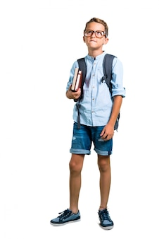Full body of student boy with backpack and glasses having doubts. back to school