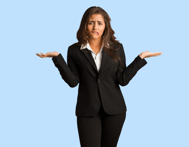 Full body young busines woman confused and doubtful