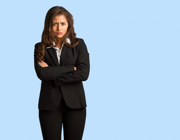Full body young busines woman crossing arms relaxed