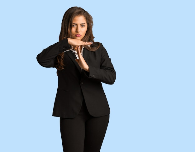 Full body young busines woman doing a timeout gesture