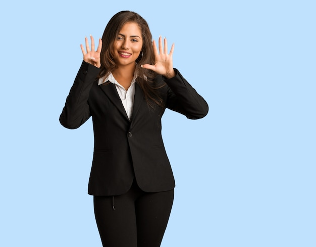 Full body young busines woman showing number nine