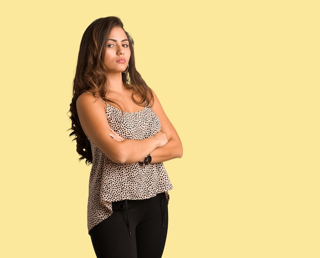 Full body young curvy plus size woman looking straight ahead