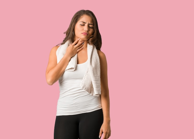 Full body young fitness curvy woman coughing, sick due a virus or infection