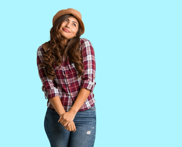 Full body young traveler curvy woman dreaming of achieving goals and purposes