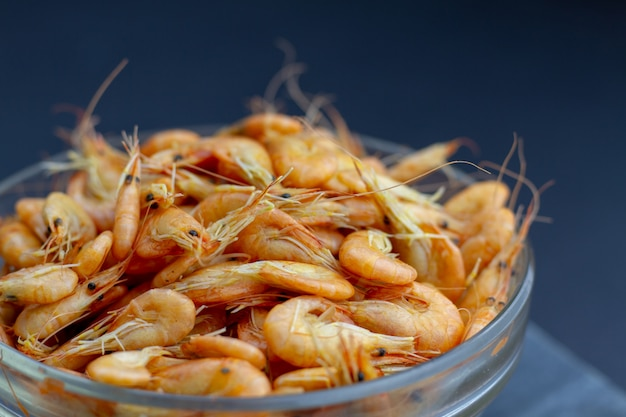 A full bowl of bright, tasty, boiled shrimp - wholesome seafood. selective focus