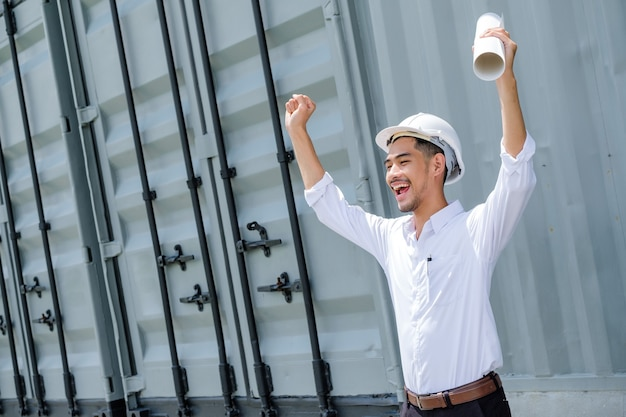 Full of energy. pleasant emotional handsome architect rising his hands