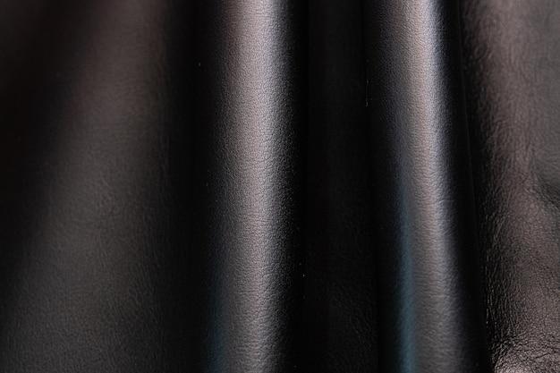 Full of folded black leather