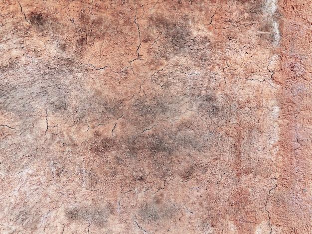 Полный кадр фон коричневой потрескавшейся грязной стены