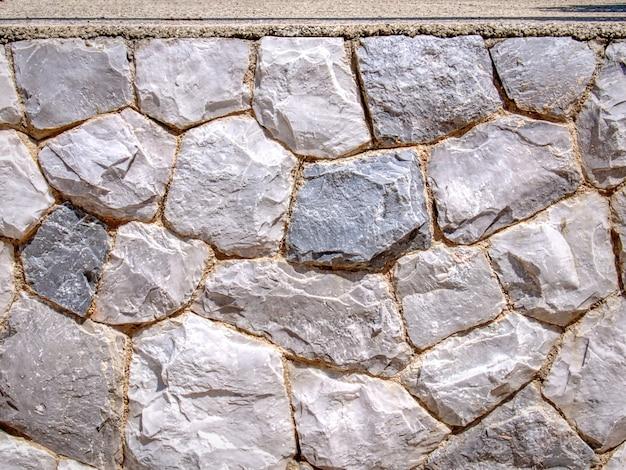 Полный кадр фон декоративной каменной стены текстуры