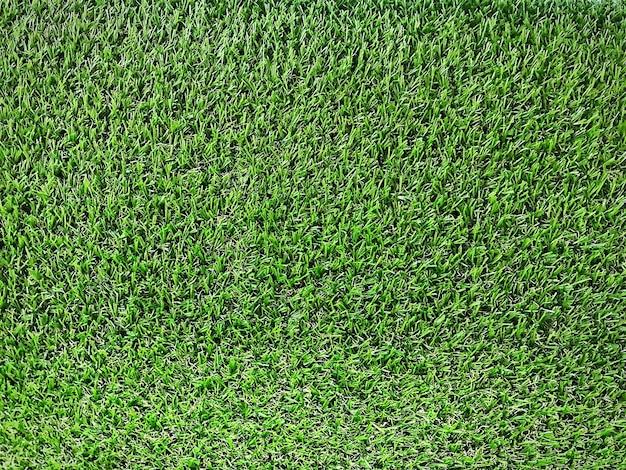 Полный кадр фон зеленой искусственной травы газона