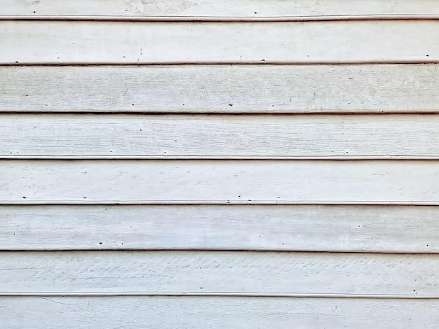 Полный кадр фон белые перекрывающиеся деревянные доски стены