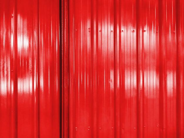 Full frame background of red corrugated door
