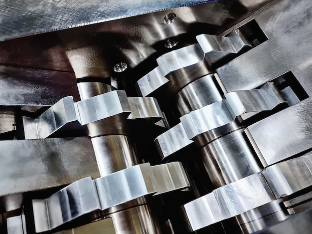 Full frame background of stainless steel teeth of parts crushing machinery