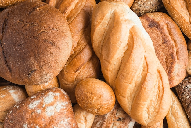 Full frame of baked breads with various shape