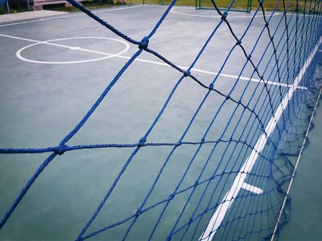 Полнокадровая синяя сетка вокруг футзального поля