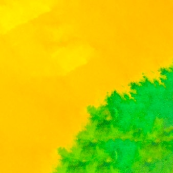 Full frame of bright yellow and green watercolor backdrop