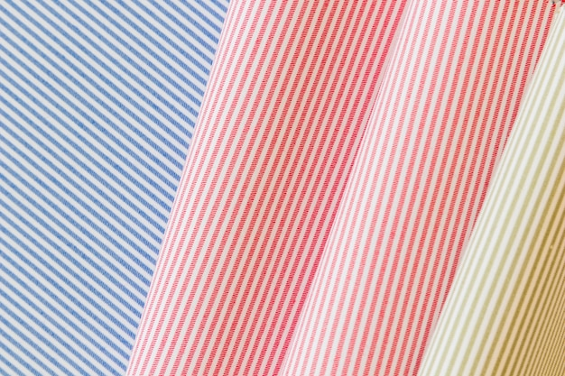 Full frame of colorful striped pattern folded fabric