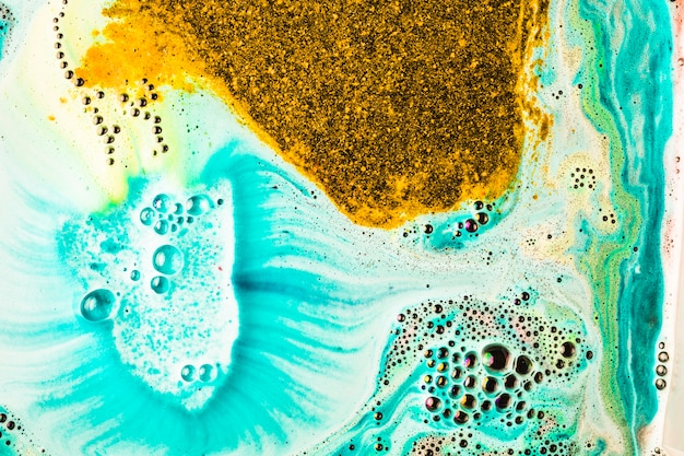 Full frame of golden and turquoise mix natural bath bomb
