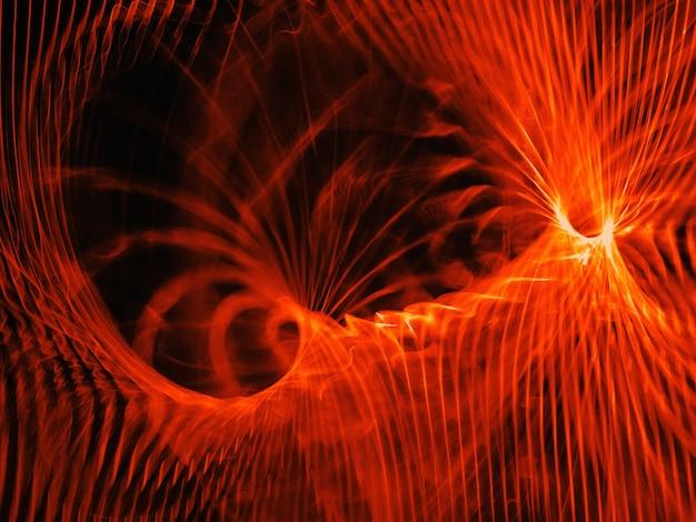フルフレームは、赤オレンジ色のらせん状の炎の抽象的な背景を示しています