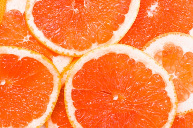 Full frame of juicy grapefruit slices