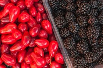 Full frame of blackberries and red rose apples