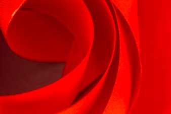 Full frame of curved red satin ribbon