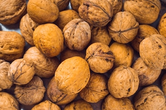 Full frame of whole walnuts