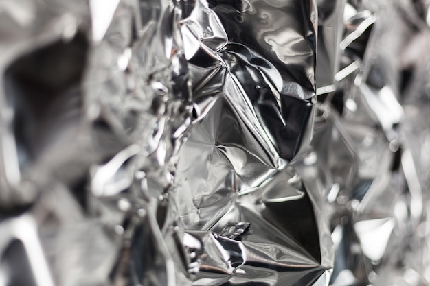 Full frame take of a sheet of crumpled silver aluminum foil