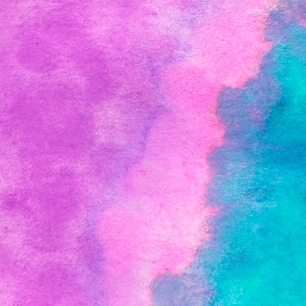 Full frame of watercolor pink and turquoise textured backdrop