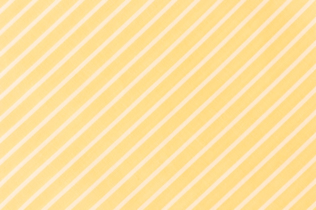 Full frame of white diagonal lines on yellow background