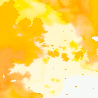 Full frame of yellow and orange watercolor brush stroke and splash backdrop
