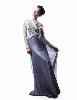 In full growth.beautiful female model in a fashionable evening dress. beauty and fashion
