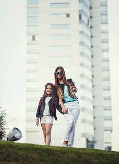 Full-height portrait of mother and daughter