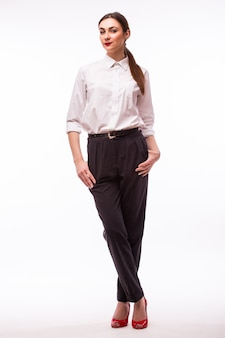 Full height portrait young pretty businesswoman on white.
