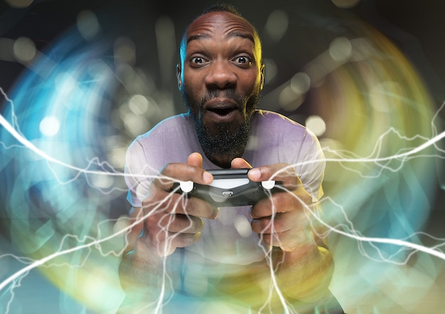 Full immersion in gameplay young man holding a video game controller isolated on colorful