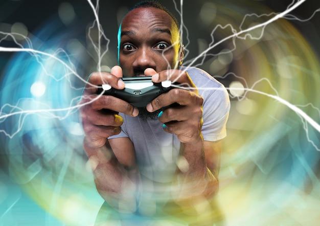 ゲームプレイに完全に没頭する孤立したビデオゲームコントローラーを保持している若い男