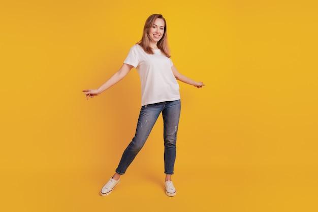 Full length body size of cheerful joyful girl dance