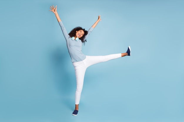 Full length body size photo of cheerful positive cute pretty sweet girlfriend in white trousers rejoicing in weekends started isolated blue pastel color background