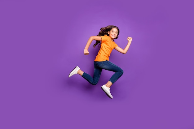Full length body size profile side view of her she nice attractive purposeful glad cheerful cheery wavy-haired girl jumping running marathon isolated over lilac purple violet pastel color background